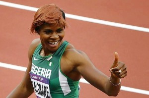 Nigeria's Blessing Okagbare gives the thumbs up sign after placing first in her women's 100m round 1 event at the London 2012 Olympic Games in the Olympic Stadium