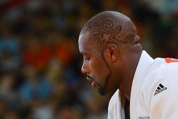 375368_le-judoka-francais-teddy-riner-lors-de-son-combat-contre-le-polonais-janusz-wojnarowicz-en-100kg-lors-des-jo-de-londres-le-3-aout-2012