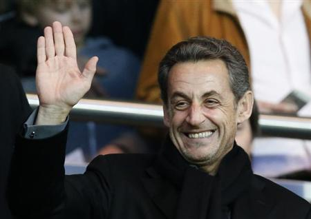 Former French President Sarkozy waves before the start of the French Ligue 1 soccer match where Paris Saint-Germain faces Nice at the Parc des Princes Stadium in Paris