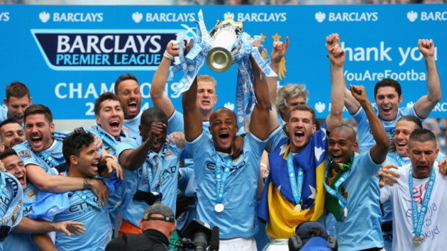 489538043-vincent-kompany-of-manchester-city-lifts-the-premier