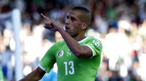 650632-algeria-s-forward-islam-slimani-reacts-after-scoring-during-the-friendly-football-match-between-alge