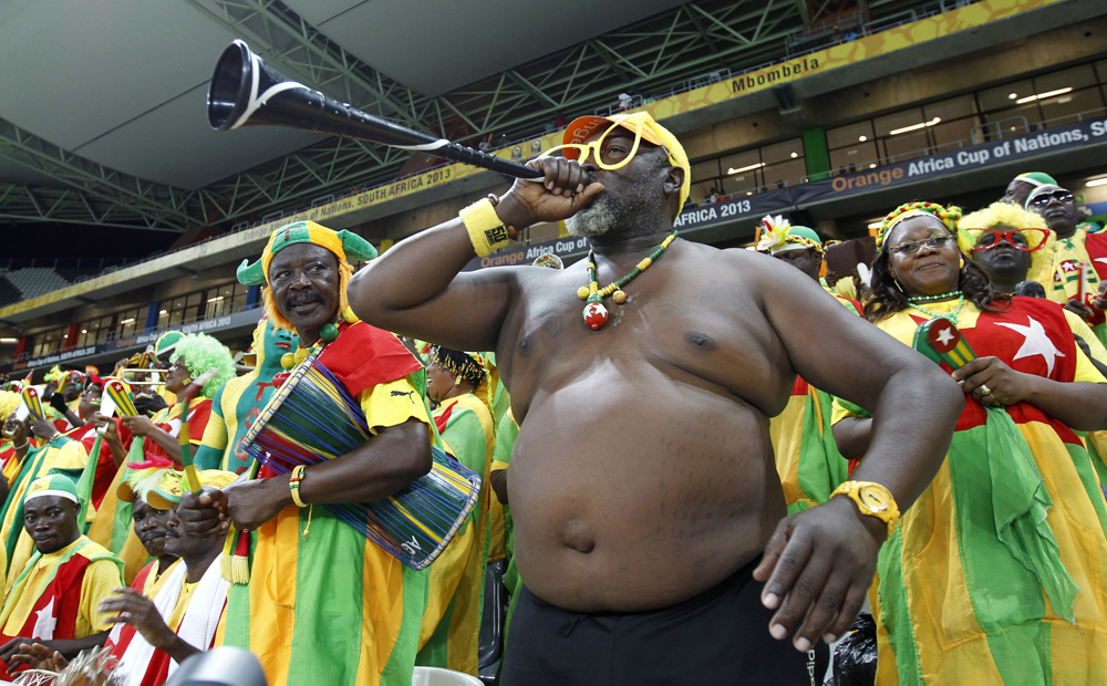 Supporters of Burkina Faso cheer during their African Cup of Nations quarter-final soccer match against Togo at the Mbombela Stadium in Nelspruit