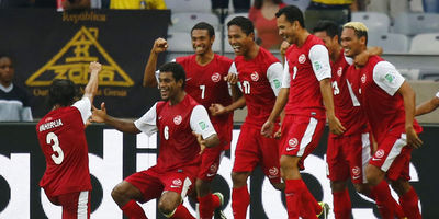 2471396_tahiti-s-players-celebrate-after-their-teammate-tehau-scored-a-goal-during-their-confederations-cup-group-b-soccer-match-against-nigeria-at-the-estadio-mineirao-in-belo-horizonte