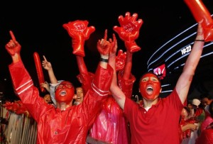 South Korean soccer fans celebrate their team's win after they watch a live TV broadcast of the 2010 World Cup Group B soccer match between South Korea and Greece in Port Elizabeth, in Seoul
