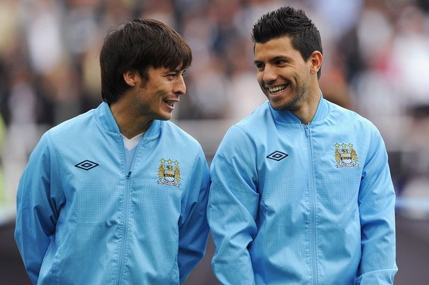David Silva and Sergio Aguero of Manchester City share a joke-840121