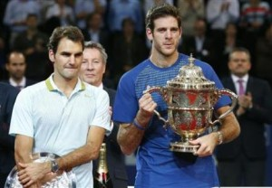 Del Potro of Argentina poses with the winner's trophy after he won his final match against Switzerland's Federer at the Swiss Indoors ATP tennis tournament in Basel