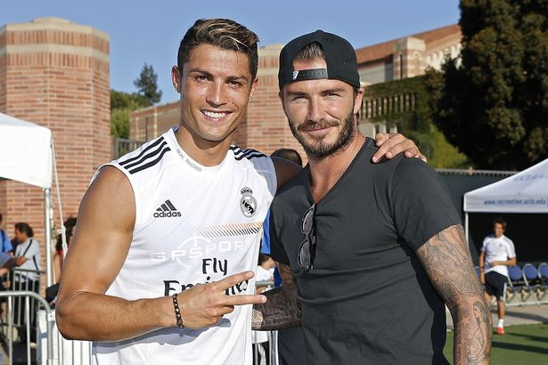 Cristiano-Ronaldo-of-Real-Madrid-and-former-player-David-Beckham-pose-after-a-training-session-at-UCLA-Campus-2103871