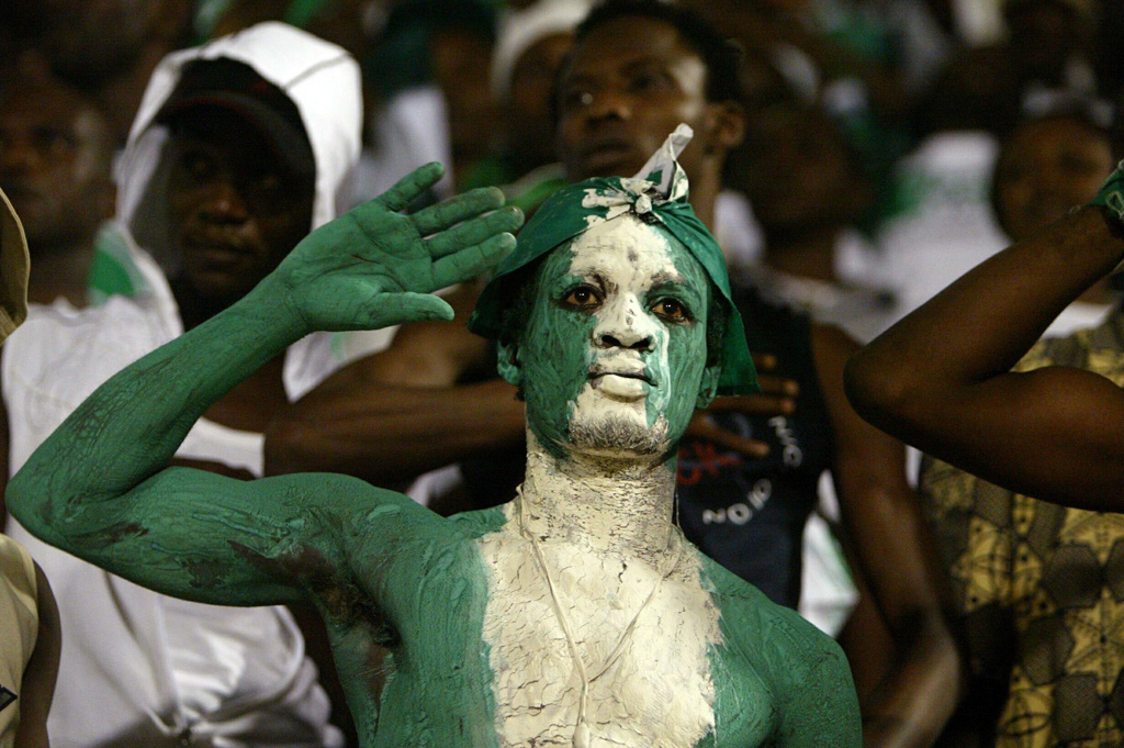Fans cheer on the Nigerian team during their World Cup qualifier soccer match against Algeria in Ora..