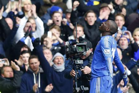 Chelsea's Demba Ba celebrates scoring against Manchester United during their English FA Cup quarter-final replay soccer match at Stamford Bridge in London, April 1, 2013. REUTERS/Andrew Winning