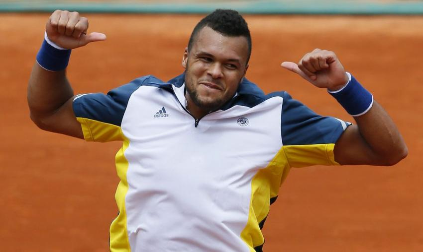 1331830-france-s-jo-wilfried-tsonga-celebrates-after-winning-agaisnt-slovenia