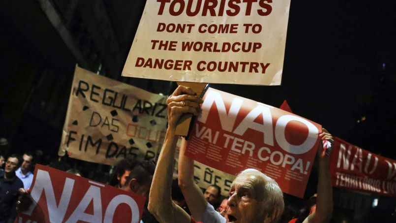 Demonstrators shout slogans during a protest against the 2014 World Cup, in Sao Paulo