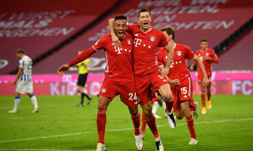 Bayern Munich players celebrate with Robert Lewandowski as he scored four against Hertha Berlin To help them bounce back to winning ways.