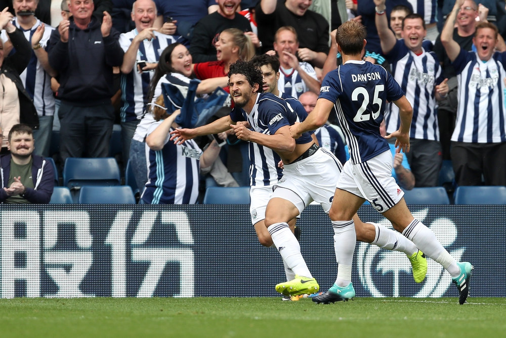 Ahmed Hegazi celebrating a goal with teammate at West Brom.