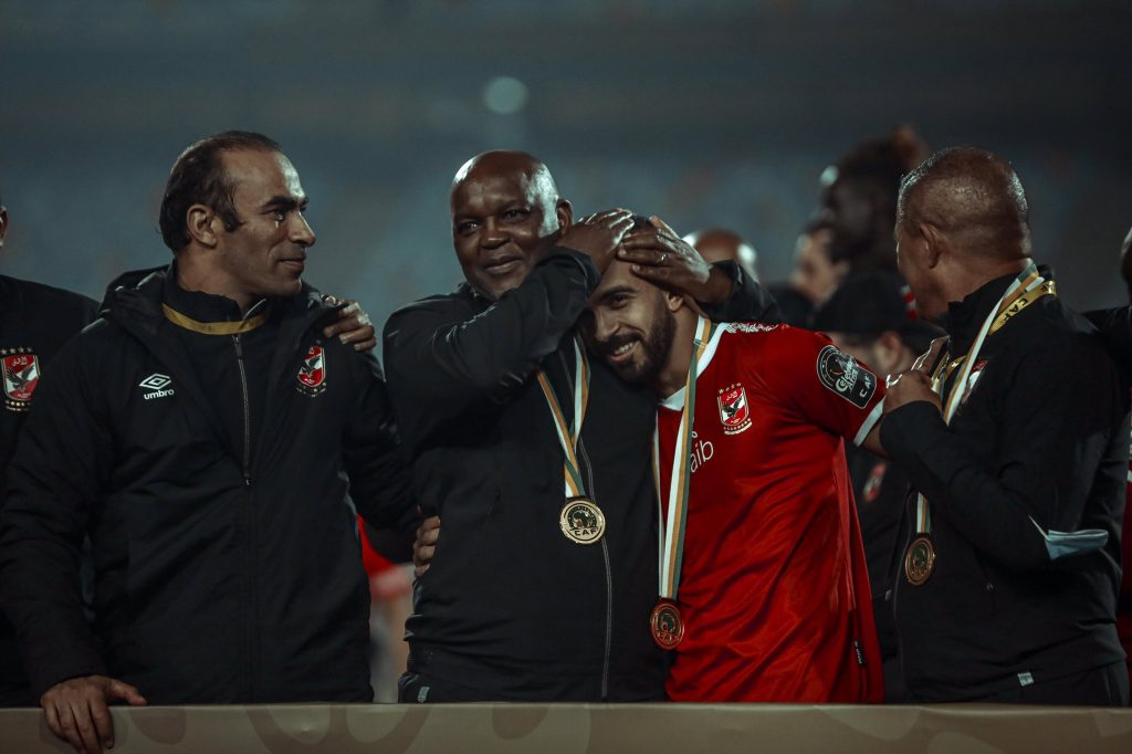 Pitso Mosimane celebrating CAF Champions league title with his players.