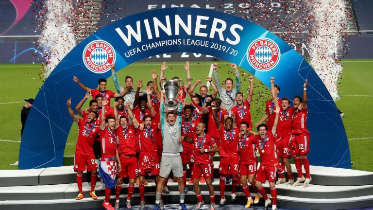 Bayern Munich celebrating the UFA Champions league trophy.
