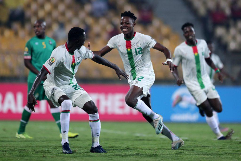 Burkina Faso celebrating against  Zimbabwe.