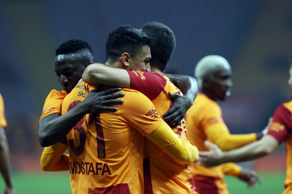 Mostafa Mohamed celebrating with his teammates.