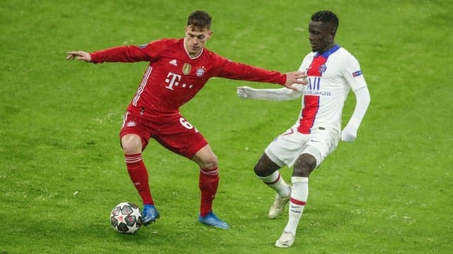 Joshua Kimmich in action against PSG's Idrissa Gueye.