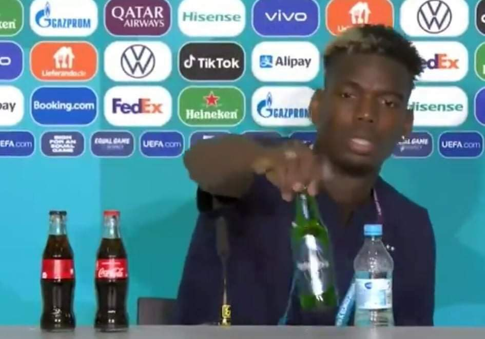 Paul Pogba removing the Heineken bottle.