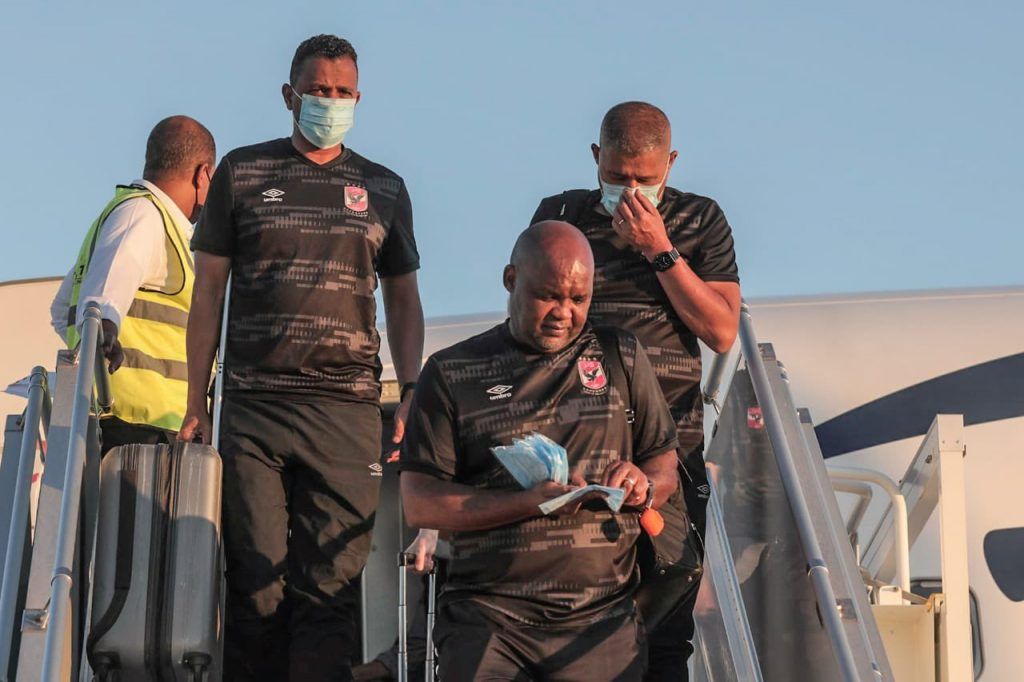Pitso Mosimane and his assistants coming off the plane.