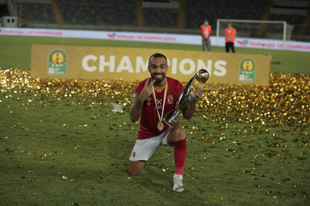 Mohamed Magdy Afsha celebrating with his 2nd CAF CL trophy.